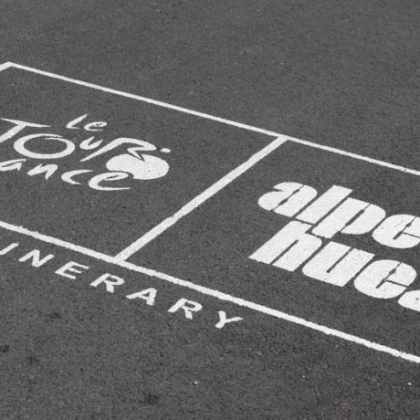 alpe d'huez road graffiti official tour logo